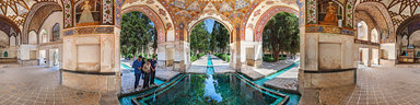 richly-decorated-fasade-over-water-fountain-in-bagh-e-fin-garden-kashan-iran